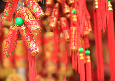 good wishes: hinese red lantern and fake firecrackers:words mean best wishes and good luck for the coming chinese new year