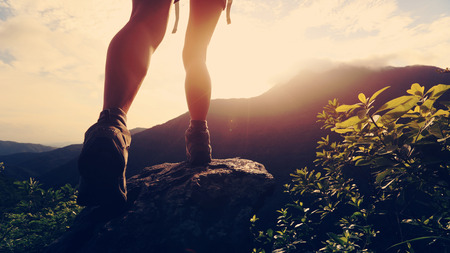 young hiker hiking on mountain peak