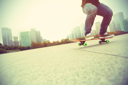 skateboard shoes: young skateboarder skateboarding at city Stock Photo