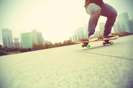 skateboard: young skateboarder skateboarding at city Stock Photo