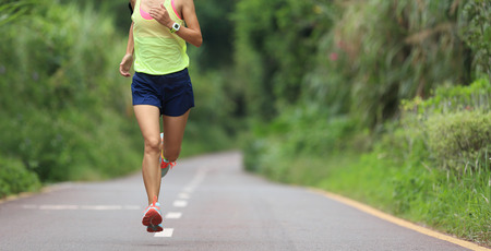 young girls nature: one young fitness woman runner running outdoor