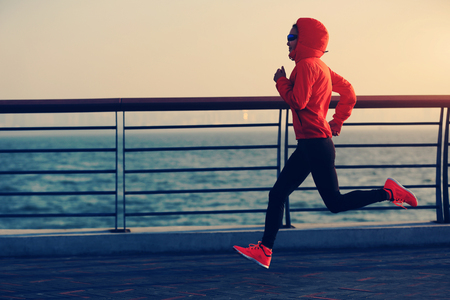 seaside: young fitness woman runner running at seaside