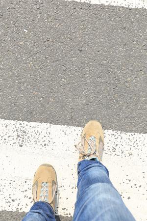 crossing legs: people legs walking on zebra crossing road