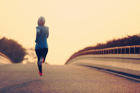legging: young fitness woman trail runner running  on city road