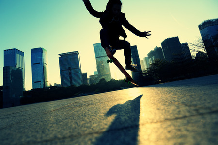 city of sunrise: skateboarder doing an ollie trick at sunrise city