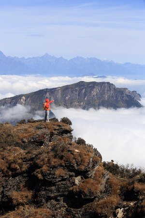 jokul: young woman backpacker hiking at mountain peak