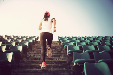 Runner athlete running on stairs. woman fitness jogging workout wellness concept. Stock Photo - 53359230