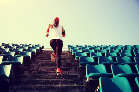 girl jogging: Runner athlete running on stairs. woman fitness jogging workout wellness concept.