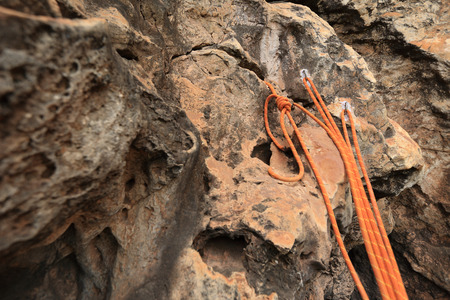 rockwall: rock climbing rope on rockwall Stock Photo