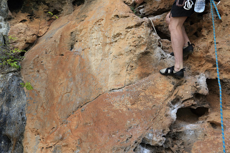 committed: rock climber climbing rock Stock Photo
