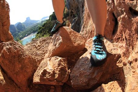 committed: rock climber legs outdoor Stock Photo
