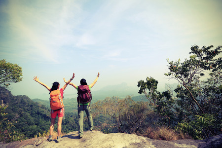 red mountain open space: two successful hiking friends enjoy the view on mountain peak