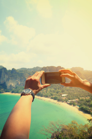 taking photo: hands taking photo with smartphone at seaside