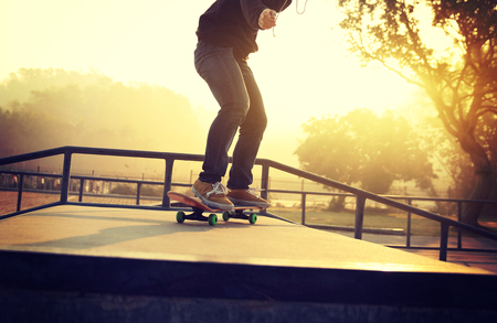 ramp: skateboarding woman riding skateboard at skatepark ramp Stock Photo