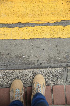 crossing legs: people legs waiting the traffic light on zebra crossing road Stock Photo