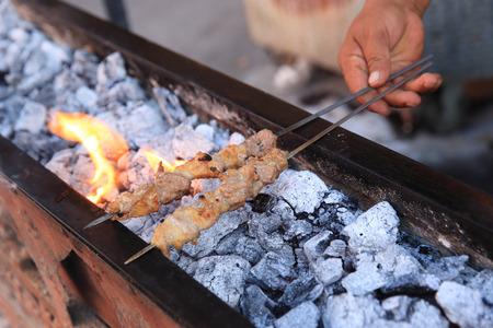 xinjiang: cooking traditional food kebab in xinjiang, china