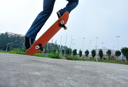 skateboarder legs riding on a skateboard Stock Photo