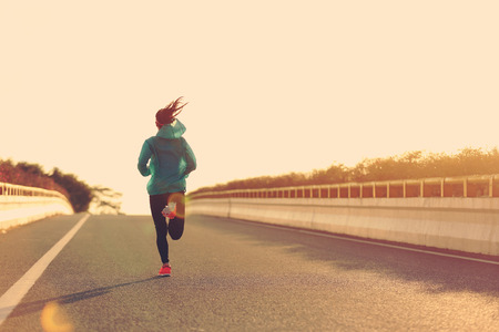 legging: young fitness woman runner athlete running at road Stock Photo
