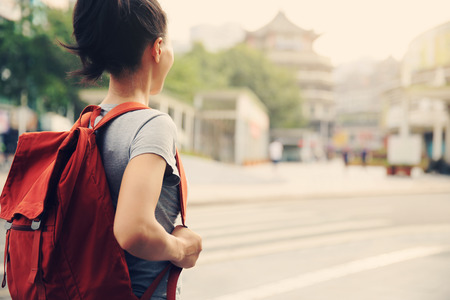 young asian woman on city street Stock Photo