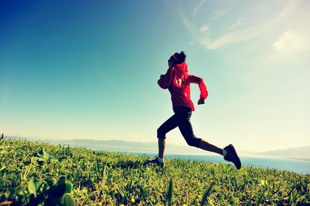 fitness young woman trail runner running on beautiful mountain peak Reklamní fotografie