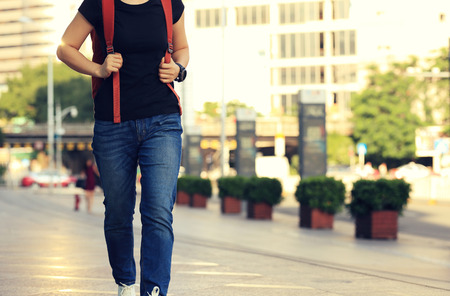 bookbag: young asian woman walking on city street Stock Photo
