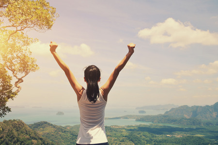 open arms: cheering young woman hiker open arms on mountain top