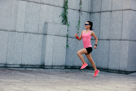 asian bodybuilder: young fitness sport woman running on city