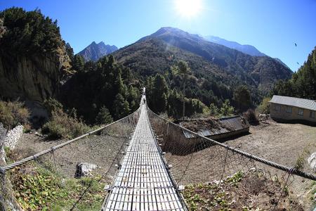 sherpa: suspension bridge over the river in Sagarmatha National Park, Himalayas, Nepal