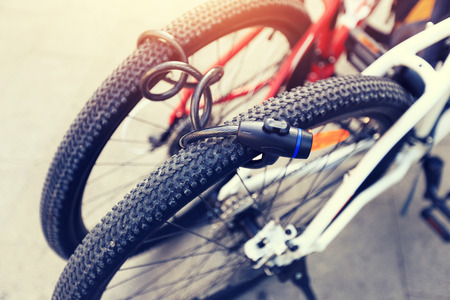 two bikes locked together in city Stock Photo