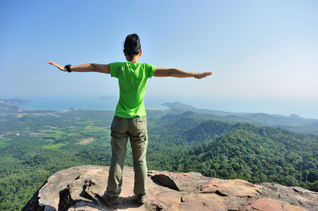 young woman hiker enjoy the view on mountain peak