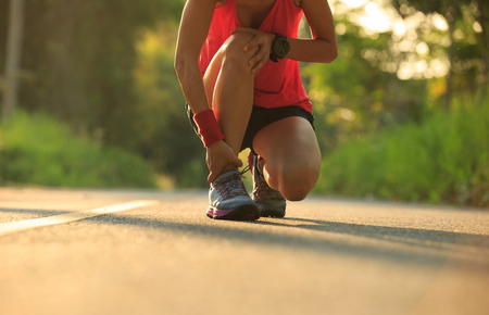 young fitness woman runner got sports injury on knee and legs