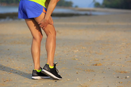 young fitness woman runner got sports injury on legs