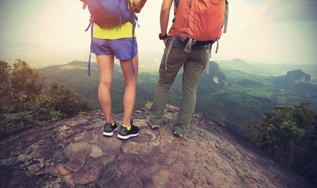 two backpackers hiking at mountain top enjoy the view Stock Photo