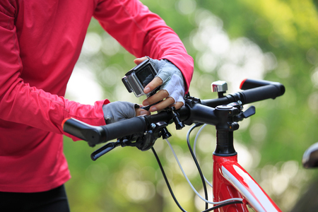 cyclist put the action camera on mountain bike Stock Photo