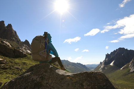 high sierra: succesful woman with backpack hiking in mountains Stock Photo