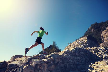 woman trail runner running at mountain top Stockfoto