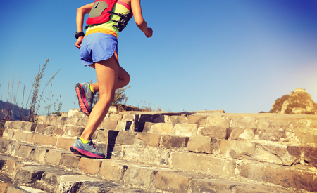 young fitness woman runner running up on stairs Stock Photo