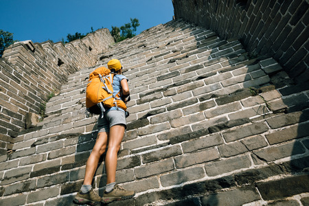woman tourist looking up on the way to climbing of great wall Stock Photo
