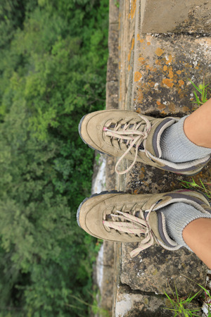 successful  hiker legs on the top of great wall Stock Photo