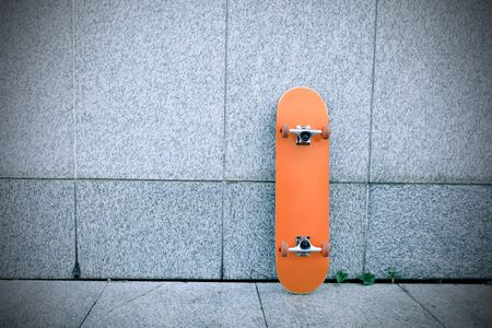 one skateboard against gray wall Stock Photo