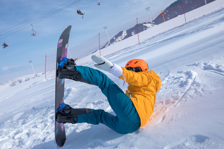 one young woman snowboarding in winter mountains Stock Photo