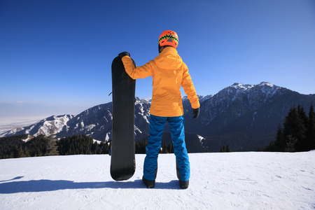 one snowboarder with snowboard on winter mountain top Stock Photo