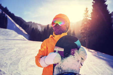 one snowboarder with snowboard in winter mountains Stock Photo
