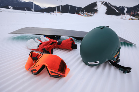 Equipment for snowboarding on track lines at ski slope left by a snowcat