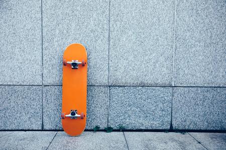 one skateboard against wall