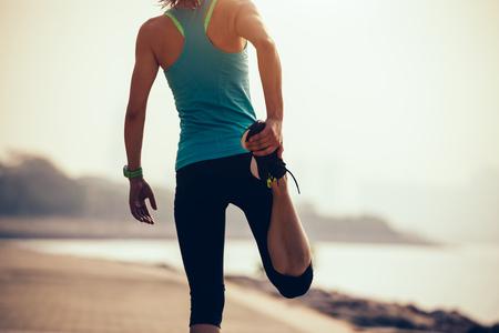 fitness sportswoman warmup on coast Stock Photo
