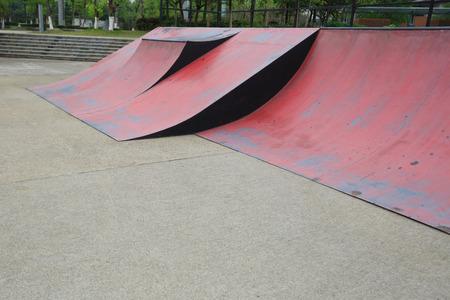 Skateboard leaning on skatepark ramp 스톡 콘텐츠