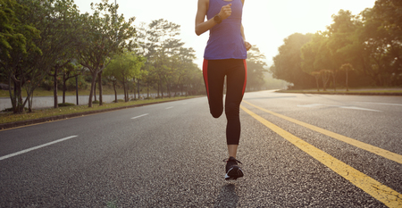 Fitness sportswoman running on sunrise trail  Stok Fotoğraf