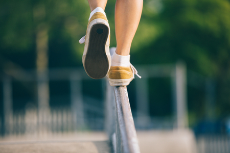 Legs walking on steel pipe with balance