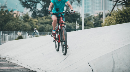 Woman freerider riding down ramps, Sports extreme and active lifestyle.